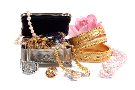 Accessory and jewelry in silver jewel chest, over white photo