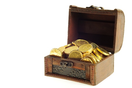 Full wooden chest of a gold euro coins on a white background, photo