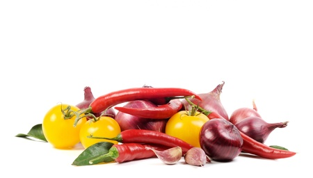 Red onions, yellow tomato and red hot chili pepper  on a white background photo