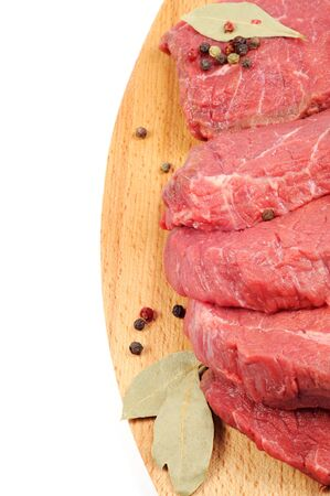 Fresh raw beef steaks , on a wooden desk,  white background photo