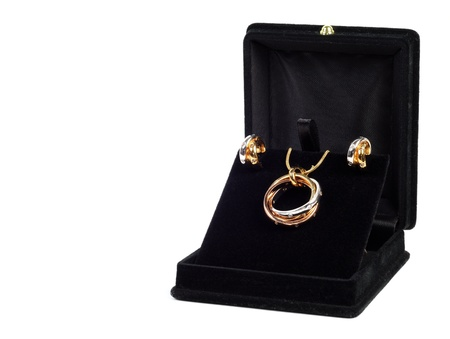 An open jewlery box with gold and platinum  jewelry set  photo