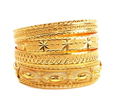 Golden bracelets , isolated on white background photo