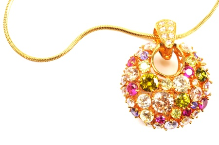 Golden necklace with colorful gems , over white photo