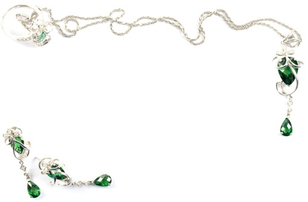 White gold beautiful  set with emerald gems, over white