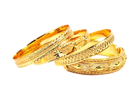 Golden bracelets , isolated on white background Stock Photo - 13727453