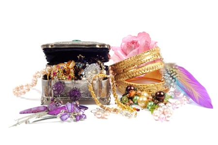 Accessory and gold jewelry in silver jewel chest, over white photo