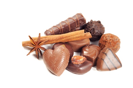 Chocolate ,anise and cinnamon, over white background photo