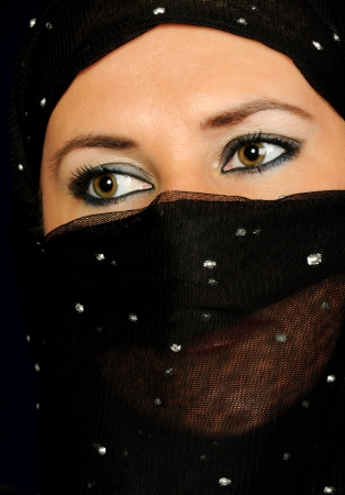 saudi: Close up picture of a Muslim woman wearing a black veil Stock Photo
