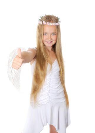 Blong girl dressed like an angel,showing thumbs up sign against white background  photo