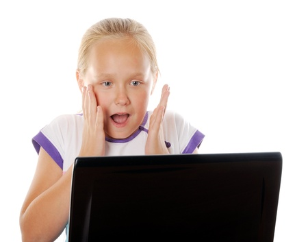 Surprised or scared girl surfing in internet, over white background photo