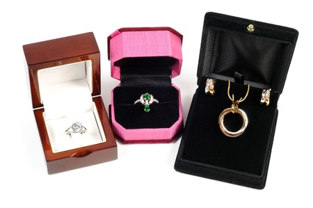 An open jewlery boxes with gold and platinum  jewelry sets on a white background photo