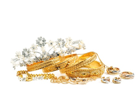 jeweler: Golden bracelets, diadema and necklece with diamonds, over white