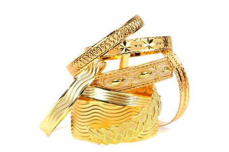 Golden bracelets ,  on a white background photo