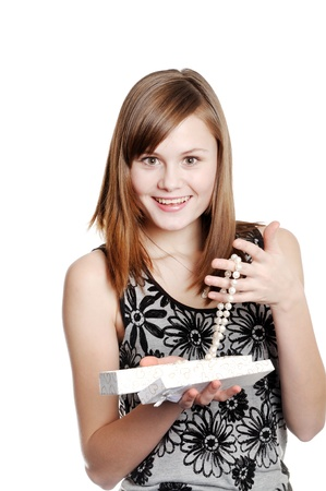 Happy teenager girl holding open gift box with pearls necklace i  Stock Photo - 21462895