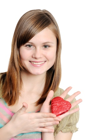 Happy smiling  girl  holding small red heart  photo