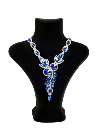 Necklace with blue gems on black mannequin isolated on white background