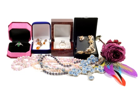 An open jewlery boxes with gold and platinum  jewelry sets on a white background
