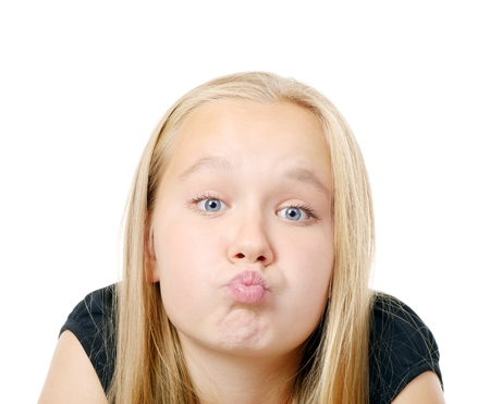 Pretty  girl making funny face, isolated on while Stock Photo - 24879265