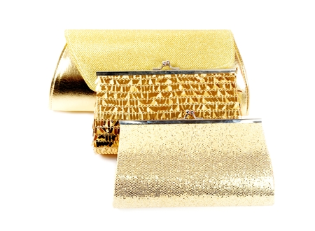 vanity bag: Golden clutches, closeup,  on a white background