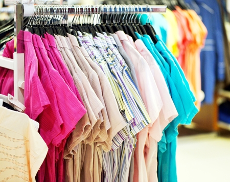 show room: Fashion clothing on hangers in the  show room
