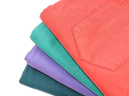 bluejeans: Stok of colorful cotton folded jeans, closeup Stock Photo