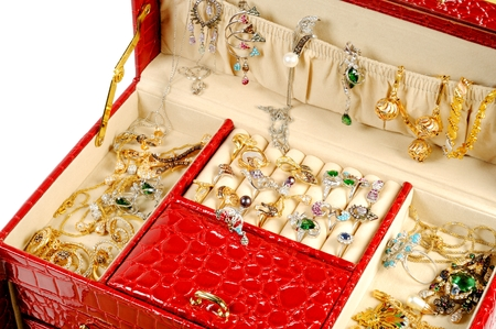 jewell: An open jewlery box with gold and platinum  jewelry inside  on a white background Stock Photo