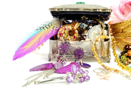 silver jewelry: Accessory and gold jewelry in silver jewel chest, over white Stock Photo