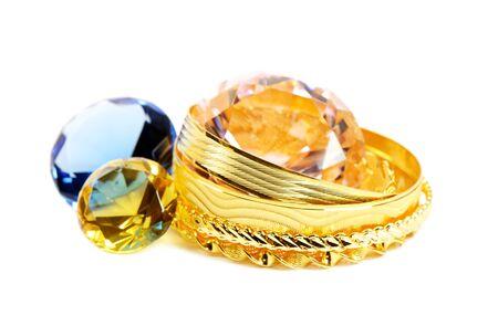karat: Golden bracelets and diamonds, over white background Stock Photo