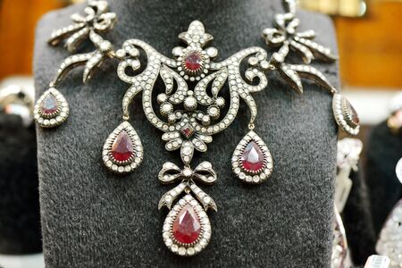 karat: Golden necklace with diamonds and ruby on mannequins Stock Photo