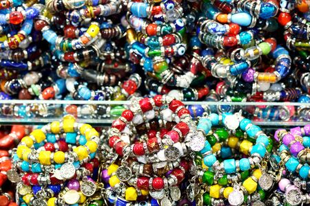 karat: Lot of colorful  bracelets with gems, closeup