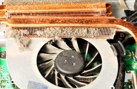 Closeup photo of a dusty dirty fan inside laptop