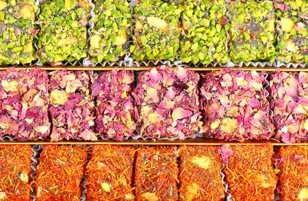 locum: Arabic sweets with rose leaves and pistachios , close up shot