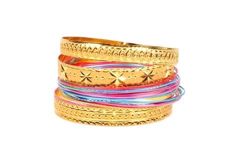 Golden bracelets on white
