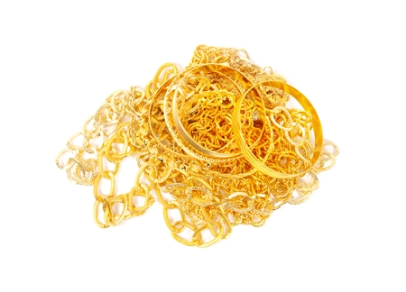 Pile of gold chains and bracelets over white Reklamní fotografie
