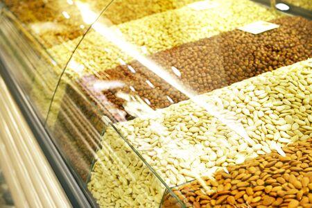 Walnut, cashew, almond and hazelnut on a shelfs.