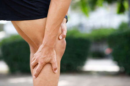 A man has a lot of knee pain , Severely injured, he was running at the park