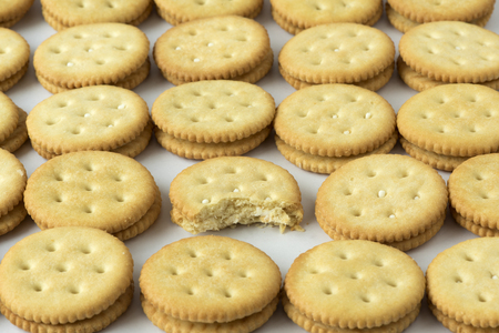 Rows of crackers on the white background