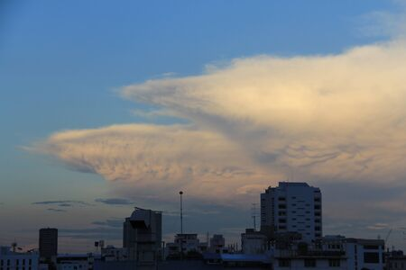 mammary: Beautiful mamma clouds over the buildings in the evening