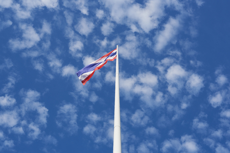 Thai national flag waving on blue sky background Stock Photo