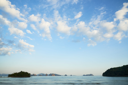 Background of blue sky and cumulus clouds over the sea at Koh Yao Noi island