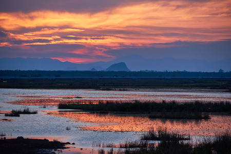 Scene of sunset and beautiful sky at Tale Noi, Phatthalung from the longest bridge in Thailand Stock Photo