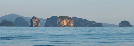 Panoramic view from the beach. Scene of mountain range and sea on blye sky background at Koh Yao Noi, Phang-Nga, Thailand
