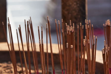 Joss-sticks and smoke in the pot during praying in the temple Stock Photo