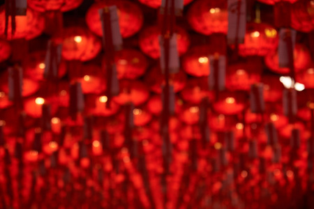 Background of blurred red chinese lantern hanging in the temple