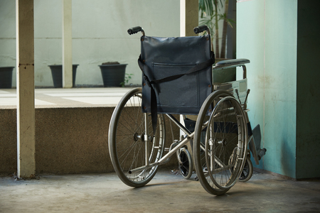 A blue wheelchair parking in the hospital
