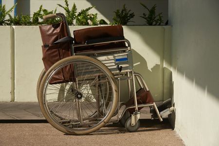A brown wheelchair parking in the hospital.