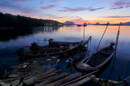 Beautiful sky in the morning during sunrise and fisherman longtail boats Stock Photo
