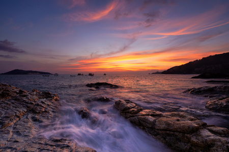 Scene of sunset and beautiful colorful sky and sea at Kalim beach, Phuket, Thailand