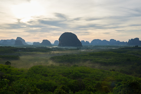 Scene from Din Deang Doi view point of mountain range and fog during sunrise in the morning at Krabi province, Thailand