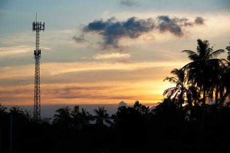 Telephone antenna on beautiful sunset sky background